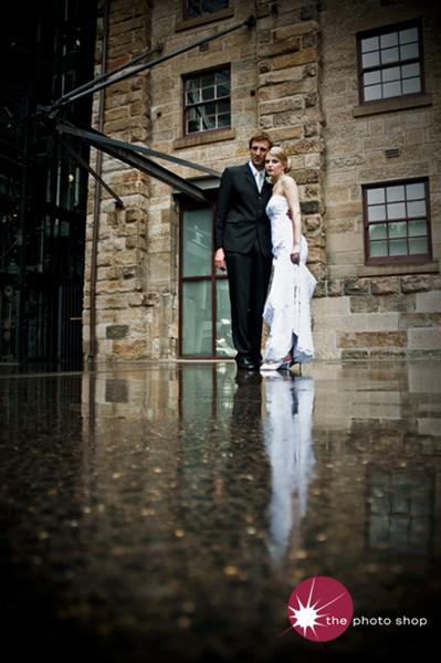 Jo and Martini stand in the rain